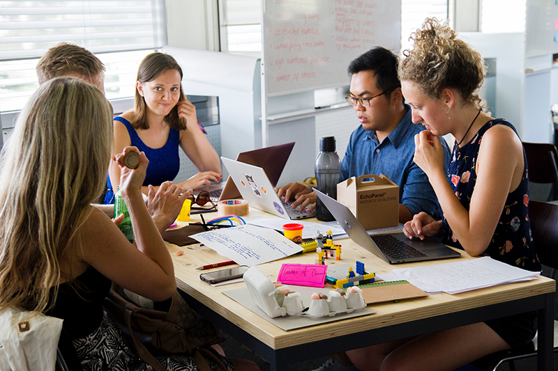 People holding a group discussion in a branding class